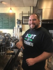 Adam Kenderdine proprietor, Benchwarmer's Coffee and Doughnuts
